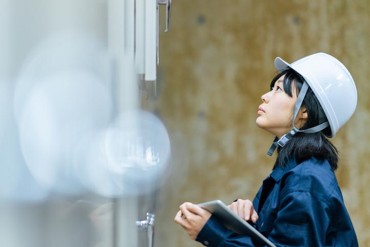 Young female engineer working at engineering facility